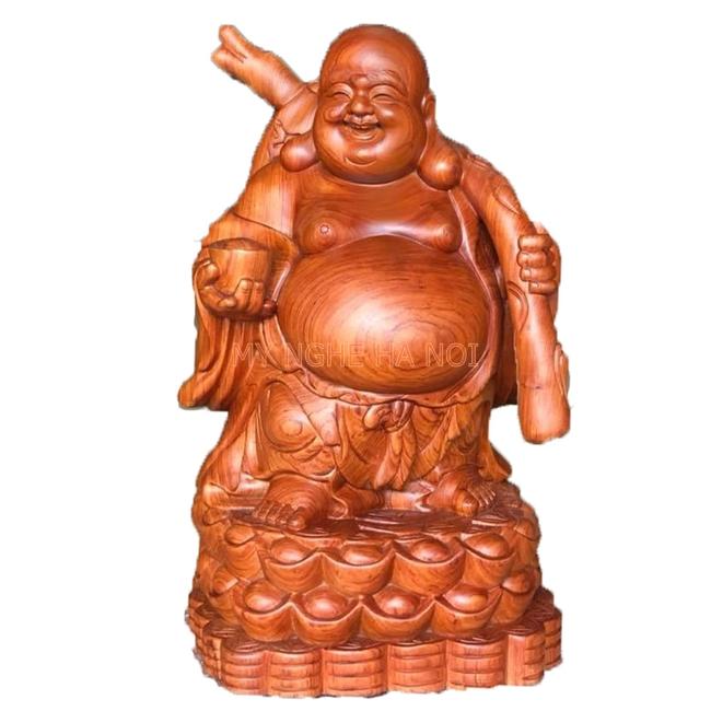 Tượng Phật Di Lắc khoác bao tiền đứng lên Tiền